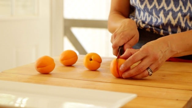 slicing apricots for Grilled Apricot Sundaes Recipe
