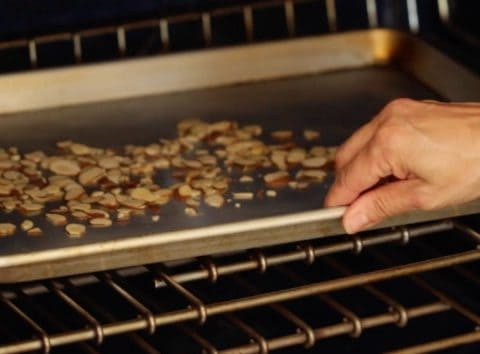 Sliced almonds going into oven