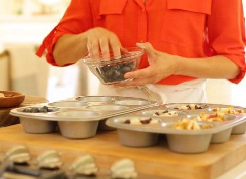 Blueberries Topping oatmeal mixture in muffin tins