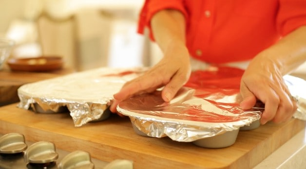Covering muffin tins with foil
