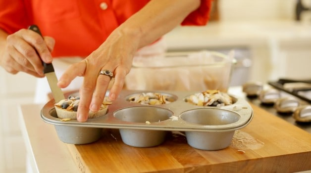 Assembling oatmeal cups in muffin tins
