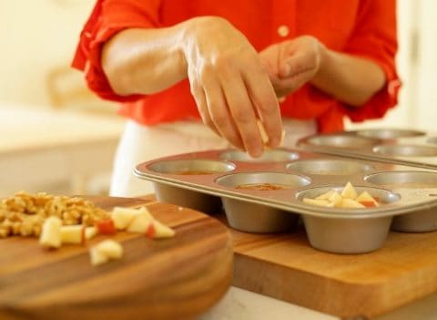 Topping oatmeal mixture in muffin tins