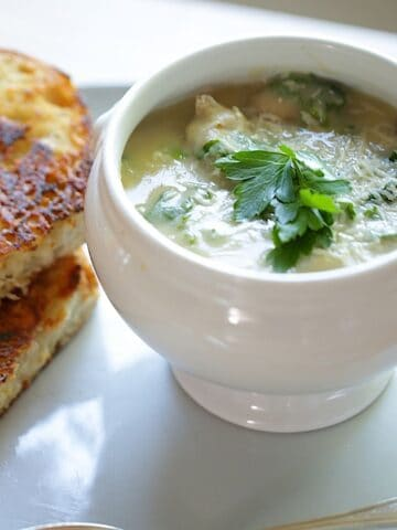 White Bean Soup in a White Bowl and Grilled Cheese Sandwich