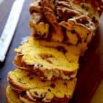 Pumpkin Cinnamon Roll Loaf on Board sliced open