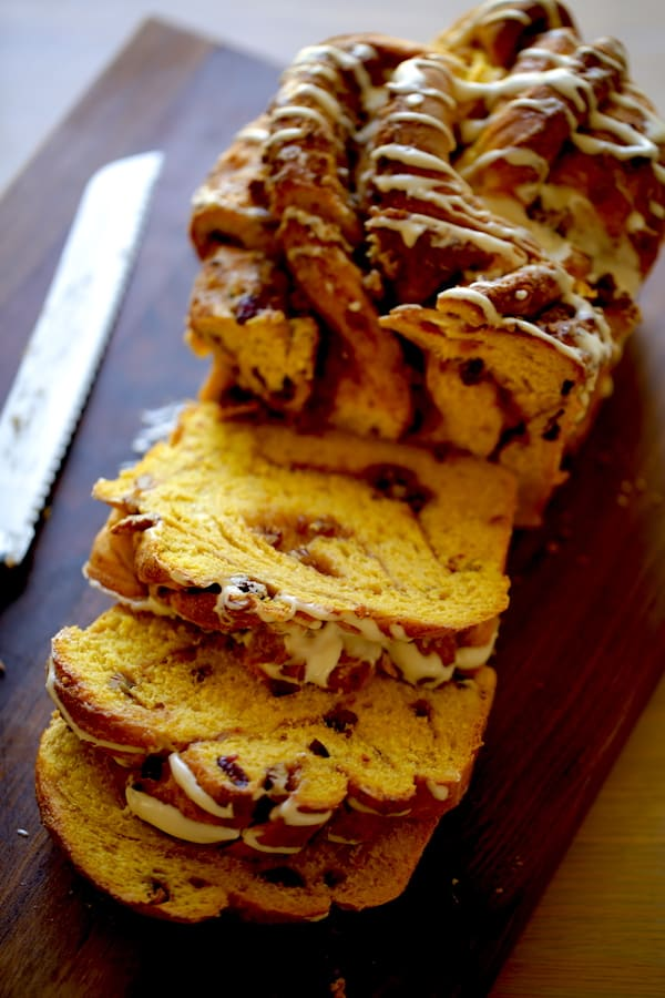 Pumpkin Cinnamon Roll Loaf on Board sliced open