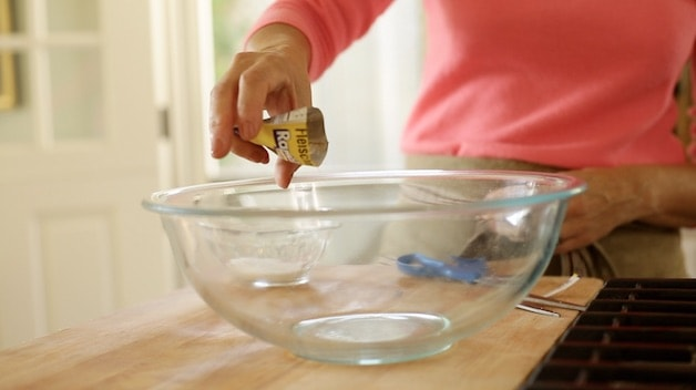 adding yeast to bowl