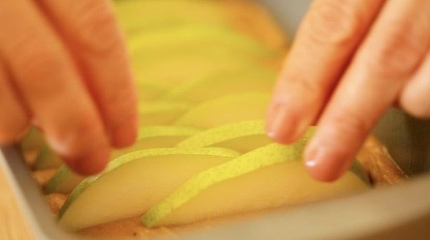 arranging pears in batter to stand upright