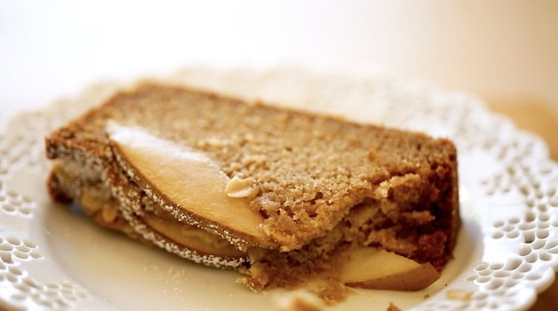 a slice of spiced pear cake on a plate