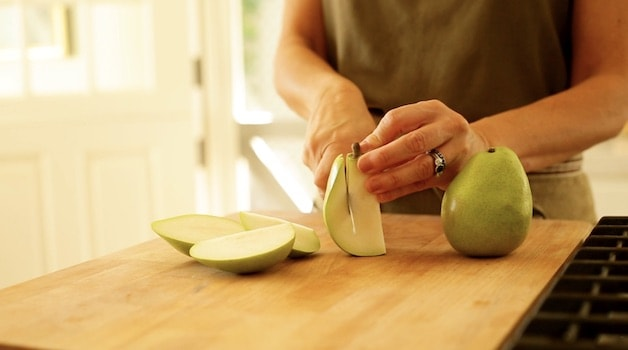 slicing hips off pears on a cutting board