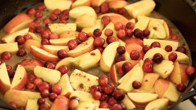 apples and cranberries in a cast-iron skillet