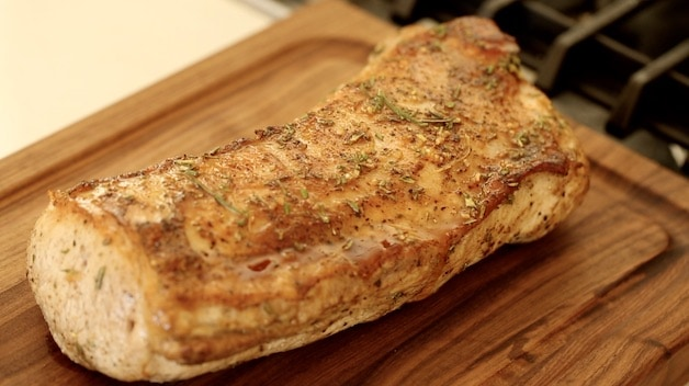 Pork Loin Roast resting on carving board
