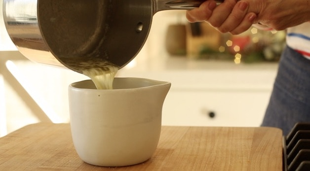 pouring melted butter into a pitcher