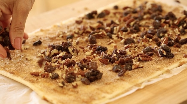 pecans and raisins and cinnamon sugar on a puff pastry sheet