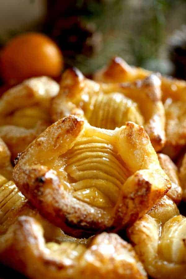 Apple Pastries on a platter with evergreens in the background