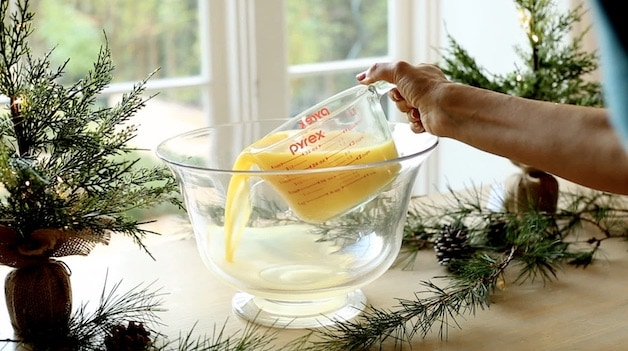 Pouring Orange Juice into a Punch Bowl
