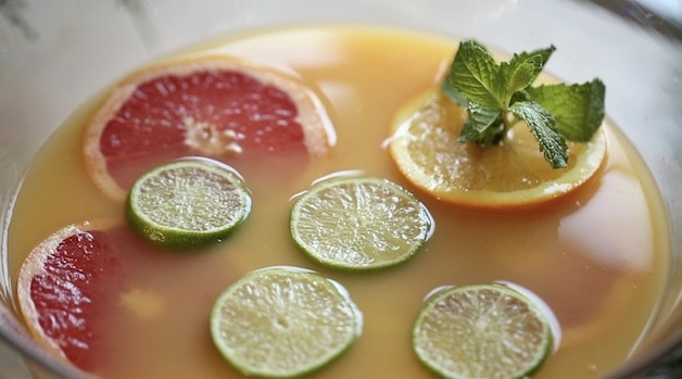 Citrus floating in Punch Recipe with Fresh Mint in Orange Wheel