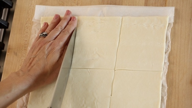 slicing puff pastry sheet into 9 squares