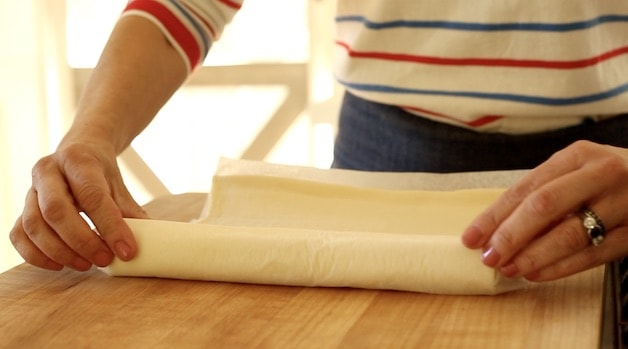 Rolling puff Pastry out on cutting board