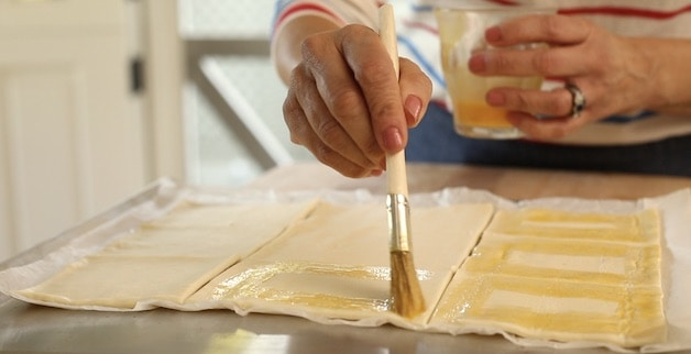 Adding egg wash to puff pastry