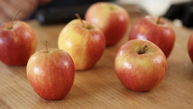 Gala apples on a wood cutting board