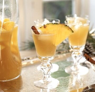 Non Alcoholic Christmas Punch on a silver tray with Pineapple Garnishes