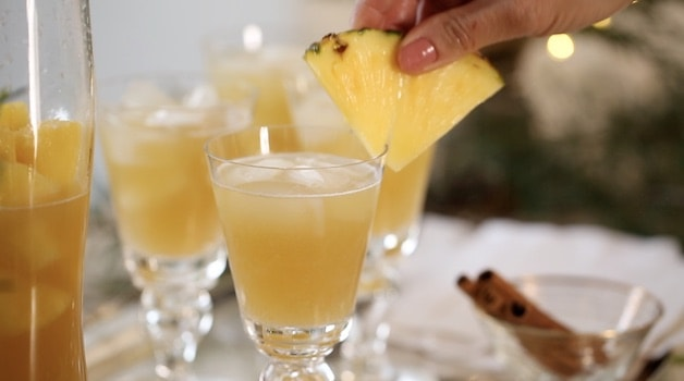 Garnishing Christmas Punch with a Pineapple wedge