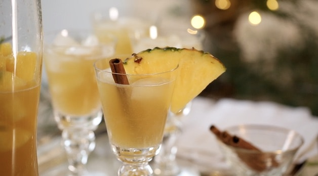 Spiced Pineapple Punch with Pineapple and Cinnamon Stick Stirrer