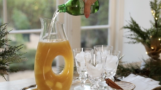 Adding Gingerale to a carafe of non alcoholic Christmas Punch