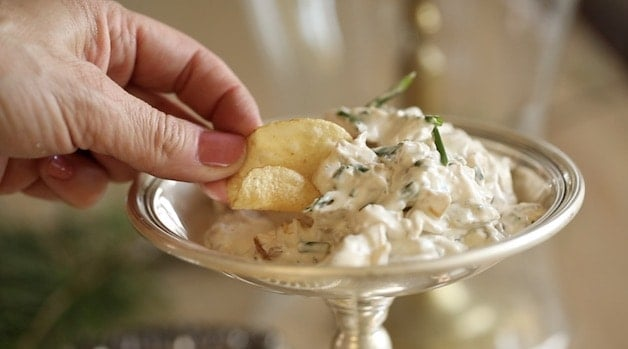 Chip in a sour cream and onion dip