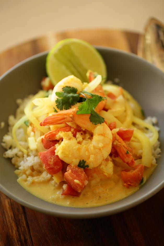 Vertical Image of shrimp curry in a bowl with cauliflower rice