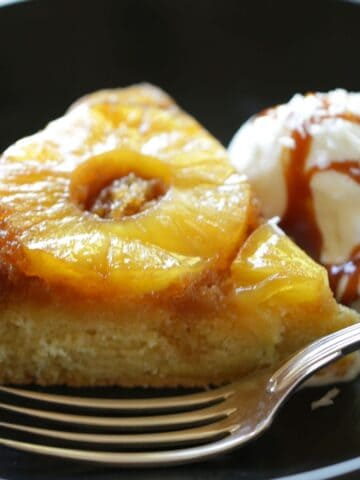a slice pf Pineapple Upside Down cake with Ice Cream