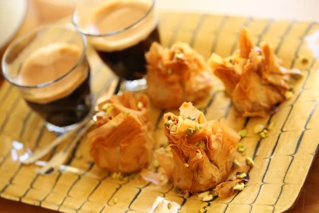 Baklava bites on a plate with coffee
