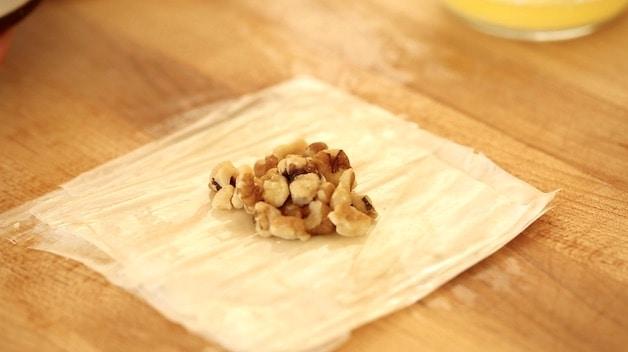 Adding Walnuts to a Square of Filo Dough