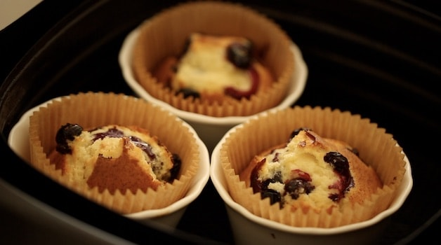 Baked blueberry muffins in an air fryer in white ramekins