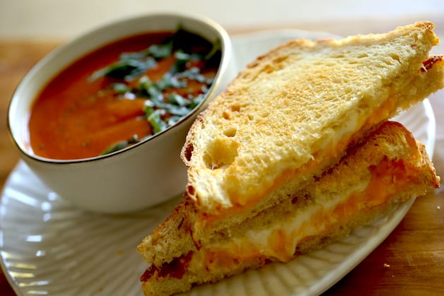 Air Fryer Grilled Cheese Sandwiches with a side of tomato soup in a bowl
