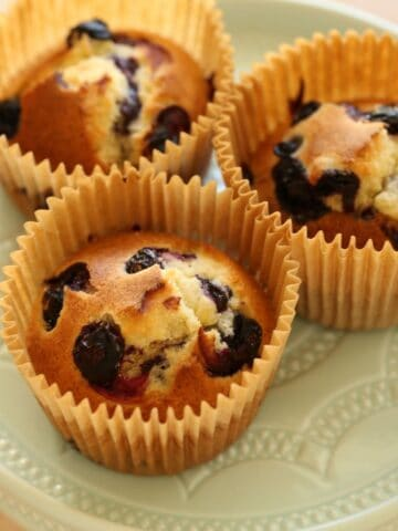 Air Fryer Blueberry Muffins on a Blue Plate