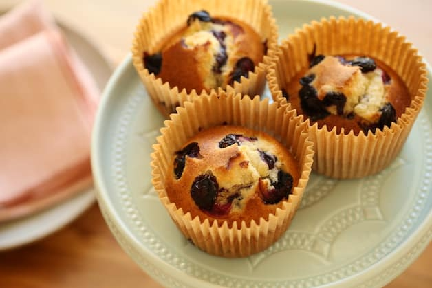 Air Fryer Blueberry Muffins on blue cake stand