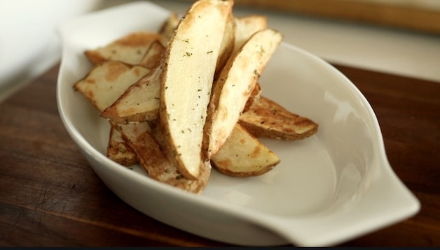 Air Fryer Potato Wedges in a white Gratin Dish