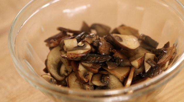 Browned mushrooms in a clear bowl