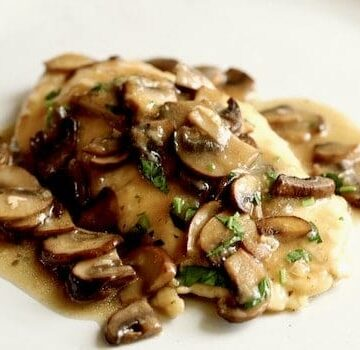 a serving of chicken marsala on a plate