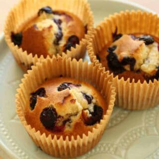 Air Fryer Blueberry Muffins on a Blue Cake Stand