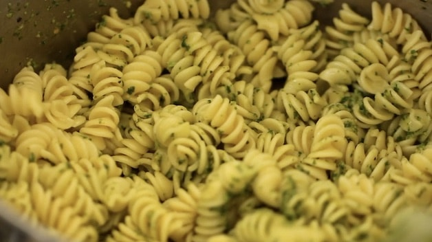 Pesto tossed with pasta