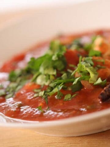 A close up of a bowl of Provencal Chicken Stew garnished with parsley