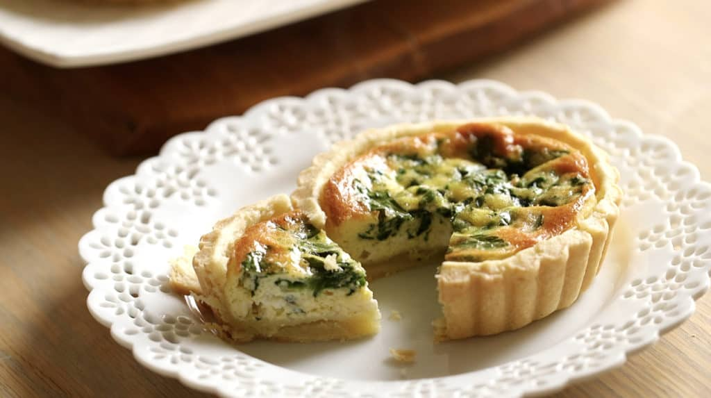 Spinach and Feta Mini Quiche on a white plate