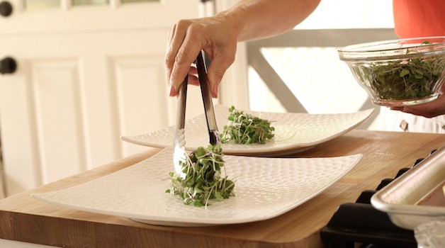 adding microgreens to a platter