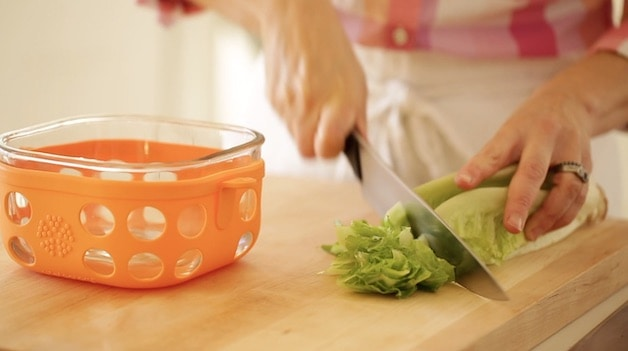 Slicing romaine lettuce on a cutting board
