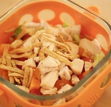 Southwestern chicken salad in an orange salad container