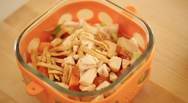 Southwestern chicken salad in an orange salad container