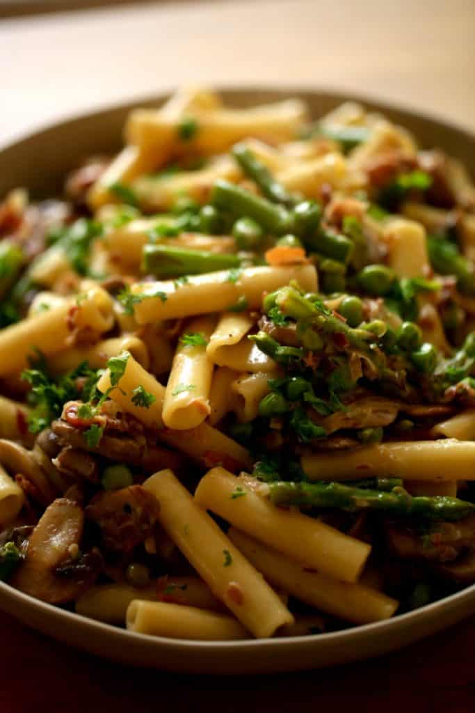 Ziti pasta with spring vegetables and Parmesan