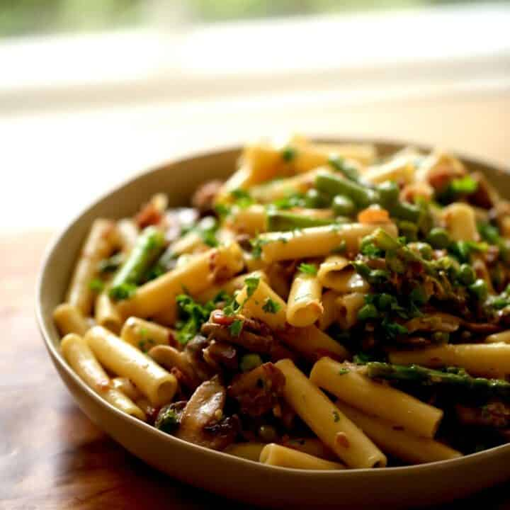 Spring Pasta with Asparagus, Peas and Mushrooms in a Large Serving Bowl